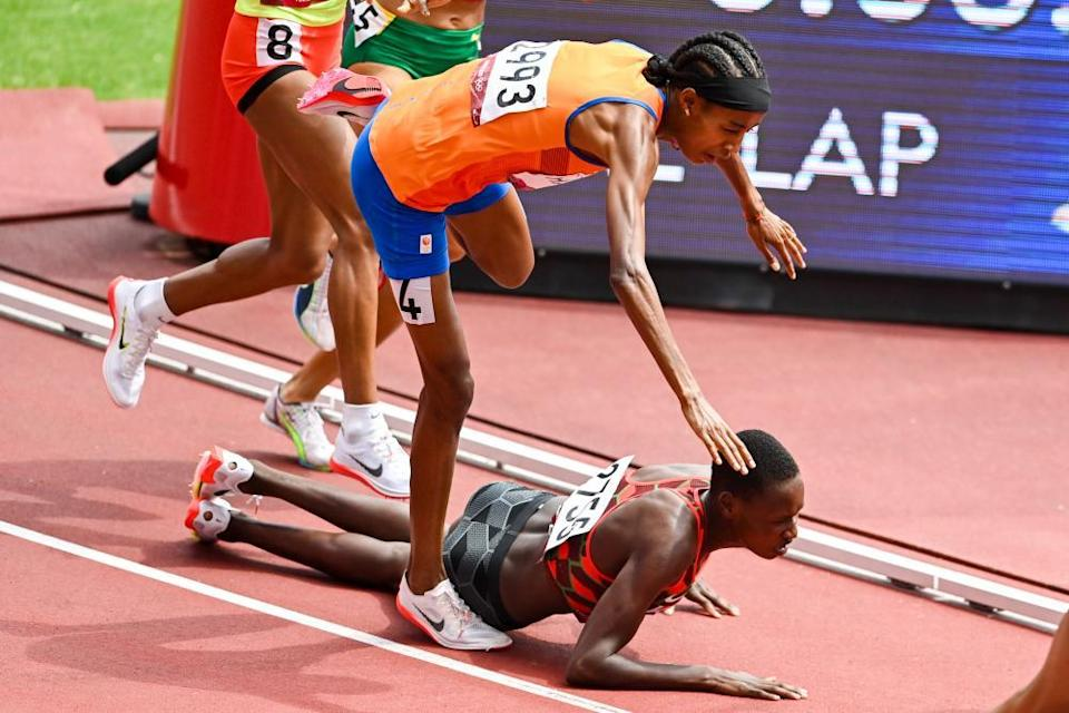 Sifan Hassan of the Netherlands falls on the final lap of her 1500m heat – she regained her feet well off the pace but recovered to win the race.