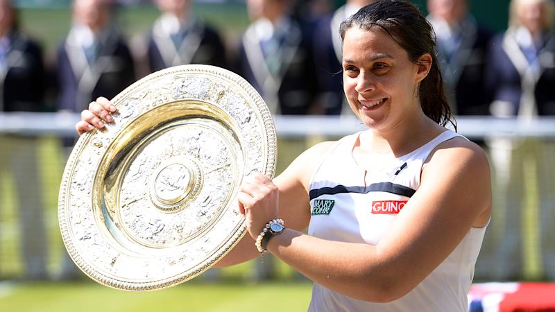 Marion Bartoli, pictured holding the 2013 Wimbledon trophy after defeating Sabine Lisicki. (Photo by EMPICS Sport - PA Images via Getty Images)