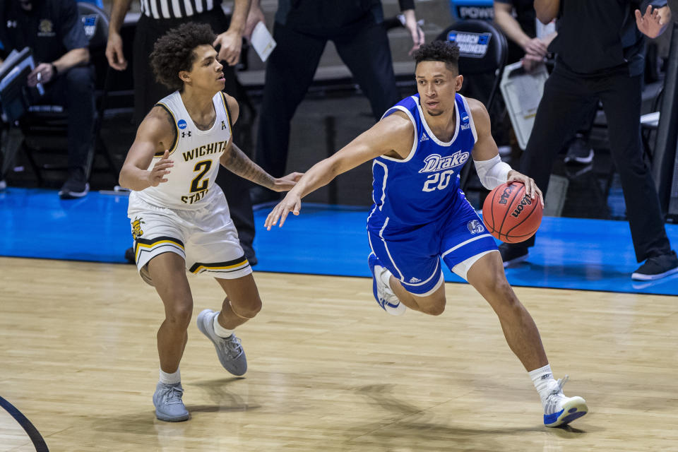 Drake's Jonah Jackson (20) drives against Wichita State's Craig Porter Jr. (2) in an NCAA tournament First Four game. (AP Photo/Robert Franklin)