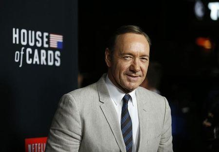 """Cast member Kevin Spacey poses at the premiere for the second season of the television series """"House of Cards"""" at the Directors Guild of America in Los Angeles, California February 13, 2014. REUTERS/Mario Anzuoni"""