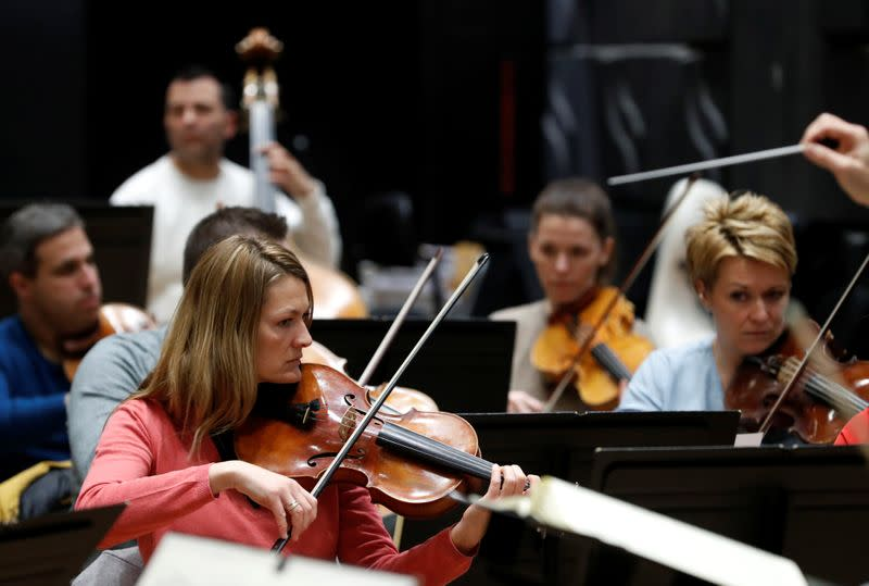 Musicians of the Danubia Orchestra perform during a rehearsal in Budapest
