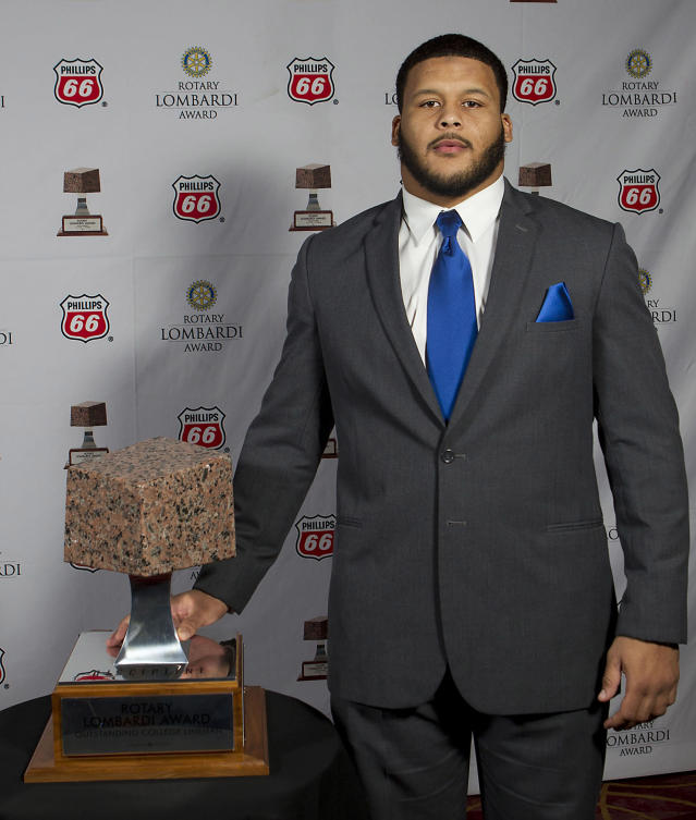 Pittsburgh defensive tackle Aaron Donald poses for a portrait with the Rotary Lombardi Award prior to the awards ceremony on Wednesday, Dec. 11, 2013, in Houston. Donald won the award on Wednesday night. (AP Photo/Houston Chronicle, James Nielsen)