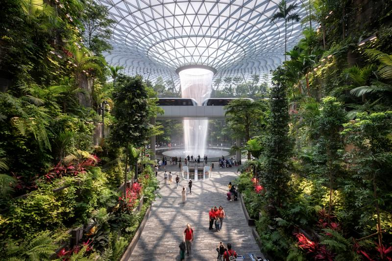 SINGAPORE - Sep 26, 2019: The Rain Vortex, a 40m-tall indoor waterfall located inside the Jewal Changi Airport in Singapore. Jewel Changi Airport.