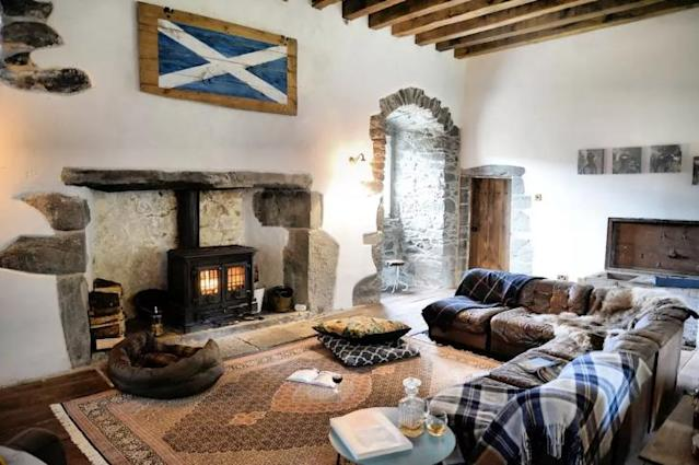 <p>Here's the castle's rustic living room with wood-beamed ceilings and a fireplace. </p>
