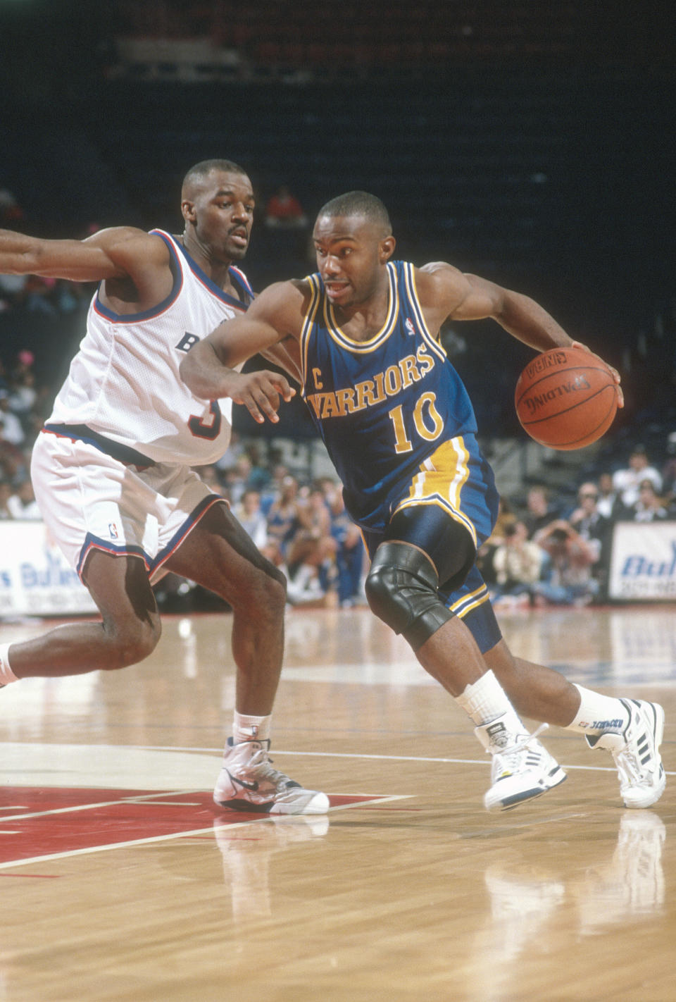 Tim Hardaway drives to the hoop in 1990. (Photo by Focus on Sport/Getty Images)