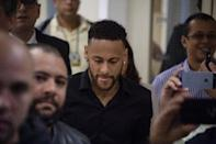Brazil star Neymar misses the Copa America due to injury but has bigger troubles to worry about after a model accused him of rape (AFP Photo/Mauro Pimentel)