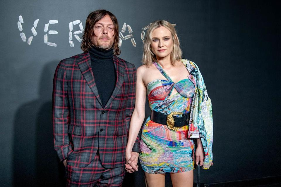 Norman Reedus and Diane Kruger attend the Versace fall 2019 fashion show on Dec. 2, 2018, in New York City. (Photo: Roy Rochlin/Getty Images)