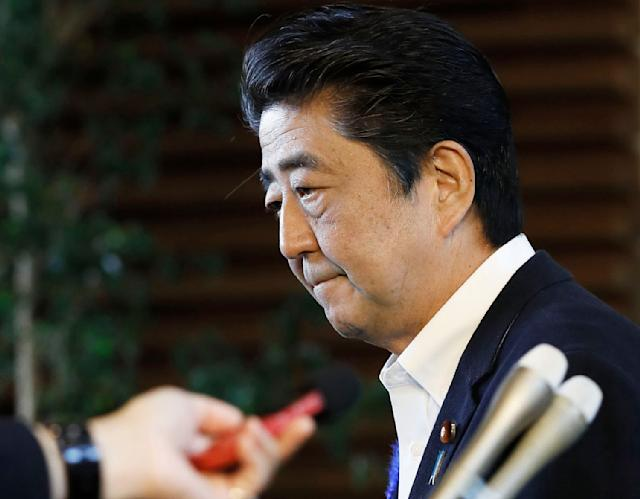 Japanese Prime Minister Shinzo Abe leaves his official residence after announcing that his government will not to appeal against damages ruling in leprosy suit, in Tokyo Tuesday, July 9, 2019. Japan says it will not challenge the recent court ruling awarding damages to former leprosy patients' families for their suffering from discrimination caused by the government's failure to end its isolation policy. (Yohei Kanasashi/Kyodo News via AP)
