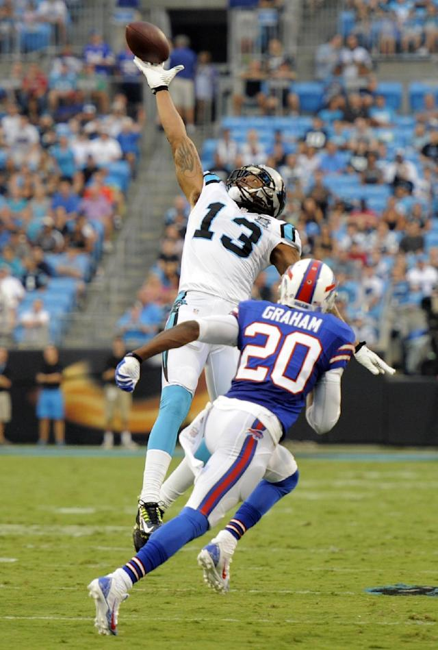 Carolina Panthers' Kelvin Benjamin (13) reaches in vain for a pass as Buffalo Bills' Corey Graham (20) defends during the first half of a preseason NFL football game in Charlotte, N.C., Friday, Aug. 8, 2014. (AP Photo/Mike McCarn)