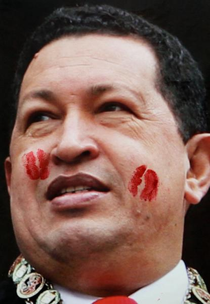 Kiss marks left by supporters of Venezuela's former President Hugo Chavez cover a photograph of him hanging on a wall near a book store during the annual book fair in Caracas, Venezuela, Tuesday, March 19, 2013. Chavez's coffin remains at the Caracas military museum since Friday, while authorities decide its final resting place. (AP Photo/Fernando Llano)