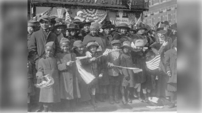 African-American families lined the streets of New York to celebrate the homecoming of the 369th Army infantry unit in 1919. (Photo: Image courtesy of the National Archives and Records Administration)