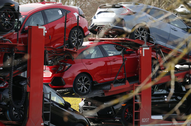 New Honda cars leave the Honda car plant in Swindon, western England, Tuesday, Feb. 19, 2019. The Japanese carmaker Honda announced Tuesday that its Swindon car plant will close with the potential loss of some 3,500 jobs. (AP Photo/Frank Augstein)