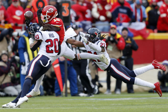 Houston Texans safety Justin Reid (20) and cornerback Bradley Roby (21) break up a pass intended for Kansas City Chiefs wide receiver Tyreek Hill (10) during the first half of an NFL divisional playoff football game, in Kansas City, Mo., Sunday, Jan. 12, 2020. (AP Photo/Jeff Roberson)