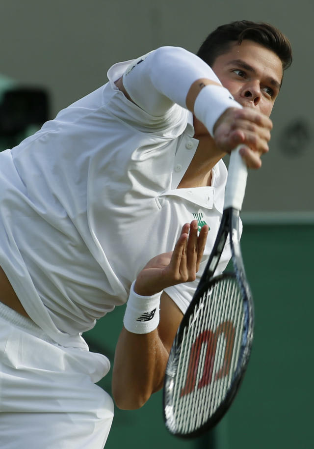 Milos Raonic of Canada serves to Lukasz Kubot of Poland during their men's singles match at the All England Lawn Tennis Championships in Wimbledon, London, Saturday, June 28, 2014. (AP Photo/Alastair Grant)
