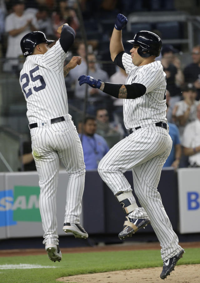 New York Yankees' Gary Sanchez, right, celebrates his two-run home run with Gleyber Torres during the eighth inning of a baseball game against the Seattle Mariners at Yankee Stadium Wednesday, June 20, 2018, in New York. (AP Photo/Seth Wenig)