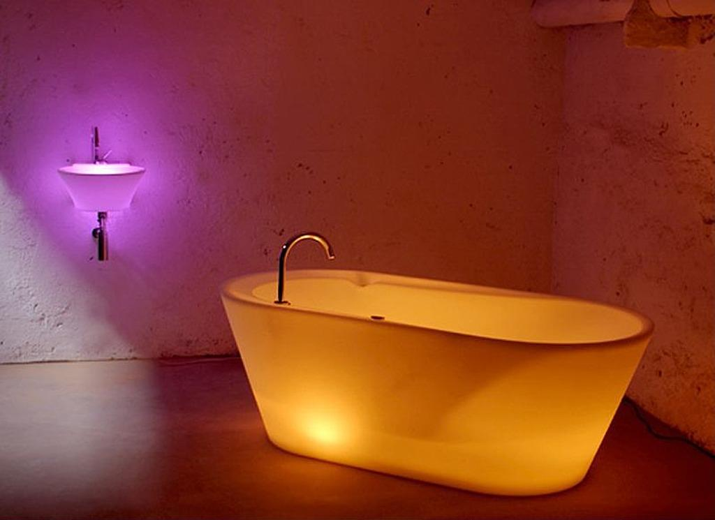 "<a href=""http://bit.ly/YWjiCS"" target=""_blank""><strong>Ready, Set, Glow</strong> </a><br /> <p>No need to bathe by candle light with a tub that glows on its own. An in-set LEDs creates for a funky bathing experience. The cost for this glowing bath is about $5,600.</p>"
