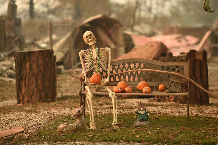 <p>A Halloween decoration remains at a burned after the Camp Fire tore through the region in Paradise, Calif., on Monday. (Photo: Josh Edelson/AFP/Getty Images) </p>