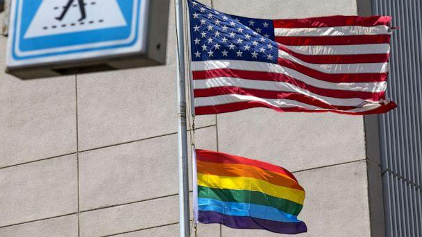 PHOTO: A gay pride flag is raised next to the US flag is at the former US embassy in Tel Aviv, June 13, 2014, in this file photo. (Jack Guez/AFP/Getty Images, FILE)
