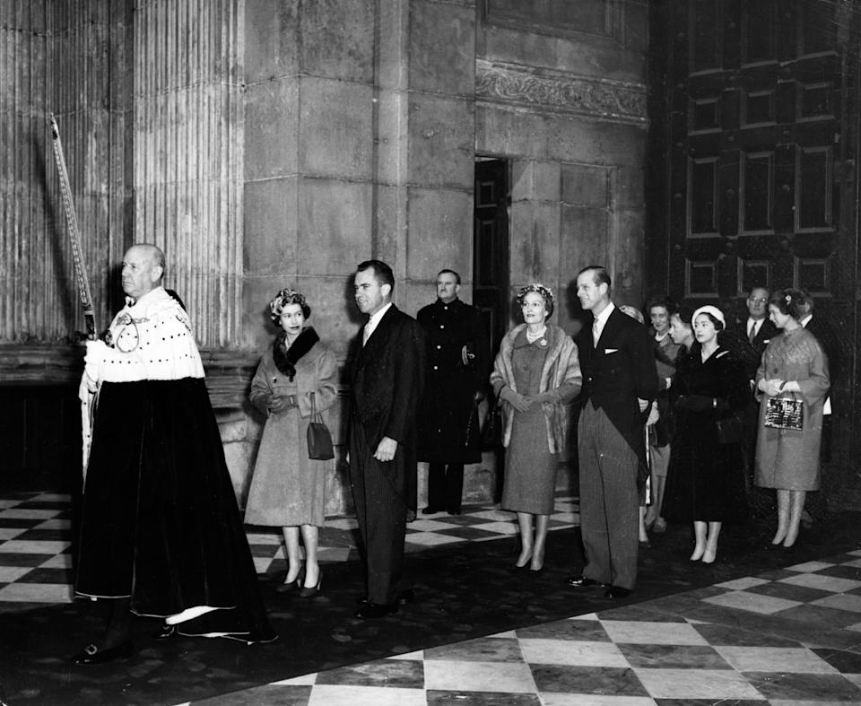 Queen Elizabeth II and American Vice-President Richard Nixon, in procession through St. Paul's Cathedral, London, for the dedication of the American Memorial Chapel. At the head of the procession is the Lord Mayor of London, Sir Harold Gillett. Following the Queen are the Duke of Edinburgh and Pat Nixon; Princess Margaret; the Duchess of Kent; the Princess Royal; Princess Alexandra; and John Hay Whitney, American Ambassador.