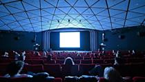 Cinemas were forced to shut during the global health crisis, delaying film releases worldwide and hitting revenues (AFP/Glyn KIRK)