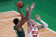 Chicago Bulls center Daniel Theis, right, tries to block Boston Celtics center Tristan Thompson, left, during the first half of an NBA basketball game, Monday, April 19, 2021, in Boston. (AP Photo/Charles Krupa)