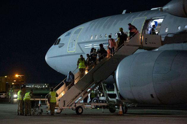 Passengers evacuated from Afghanistan landing at RAF Brize Norton (Photo: JUSTIN TALLIS via Getty Images)