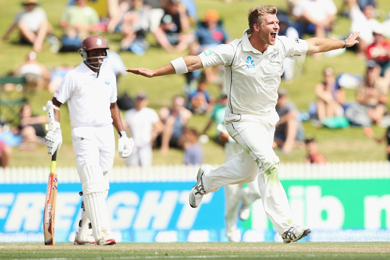 HAMILTON, NEW ZEALAND - DECEMBER 21:  Corey Anderson of New Zealand celebrates the wicket of Marlon Samuels of the West Indies during day three of the Third Test match between New Zealand and the West Indies at Seddon Park on December 21, 2013 in Hamilton, New Zealand.  (Photo by Hannah Johnston/Getty Images)
