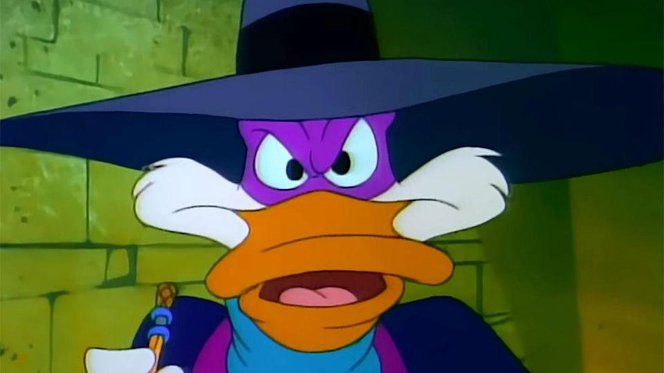 <p> The avian world&#x2019;s answer to Batman, Darkwing Duck is set in an entirely different universe to DuckTales, despite there being several crossover characters. Darkwing, the secret identity of Drake Mallard, always does the right thing in the end, but does struggle a little too much with keeping his ego in check. He&#x2019;s joined by a loyal sidekick in the form of Launchpad McQuack &#x2013; a lovable, dimwitted pilot who also happens to Darkwing&#x2019;s number one fan. </p> <p> Darkwing Duck may have been a staple of Disney&#x2019;s afternoon lineup in the &apos;90s, but it was also of a slightly different breed to the rest. While DuckTales and Talespin work as broad adventure stories, Darkwing was created as a parody of the pulp heroes and comic book characters of the &apos;30s and &apos;40s. Even the city of St. Canard was clearly based on Gotham City. It&#x2019;s a silly, light-hearted homage to the past greats. </p>