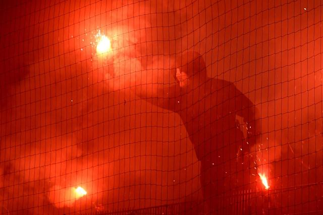 Soccer Football - Bundesliga - Hamburger SV v Borussia Moenchengladbach - Volksparkstadion, Hamburg, Germany - May 12, 2018 Hamburg fan lets off a flare REUTERS/Fabian Bimmer DFL RULES TO LIMIT THE ONLINE USAGE DURING MATCH TIME TO 15 PICTURES PER GAME. IMAGE SEQUENCES TO SIMULATE VIDEO IS NOT ALLOWED AT ANY TIME. FOR FURTHER QUERIES PLEASE CONTACT DFL DIRECTLY AT + 49 69 650050