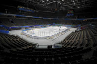 Capital Institute hockey team players practice at the ice hockey venue for the 2022 Beijing Winter Olympics during a test event at the National Indoor Stadium in Beijing, Thursday, April 1, 2021. Chinese capital hold a 10 days test events for 2022 Beijing Winter Olympics in five different venues from April 1-10, becomes the first city to hold both the Winter and Summer Olympics. (AP Photo/Andy Wong)
