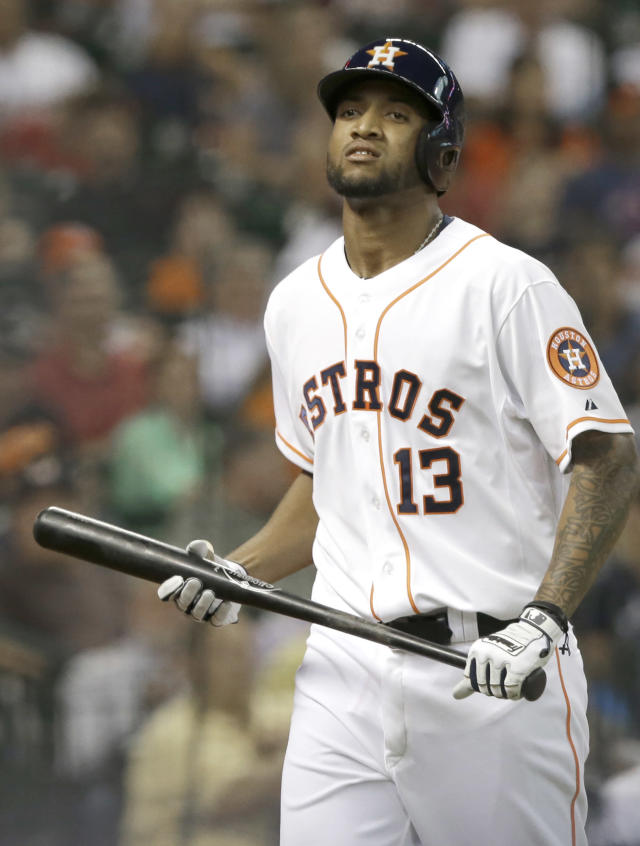 Houston Astros' Domingo Santana walks off after striking out against the Seattle Mariners to end the fourth inning of a baseball game Tuesday, July 1, 2014, in Houston. (AP Photo/Pat Sullivan)