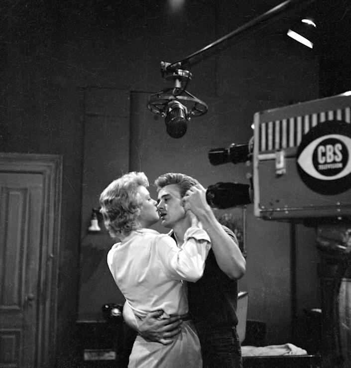 <p>Throughout the '50s, Dean scored minor roles in big pictures like <em>Fixed Bayonets!, Sailor Beware, </em>and shows like <em>Kraft Television Theater</em>. Here, Dean is seen dancing in a scene with actress Betsy Palmer in the CBS show, <em>Danger</em>. </p>