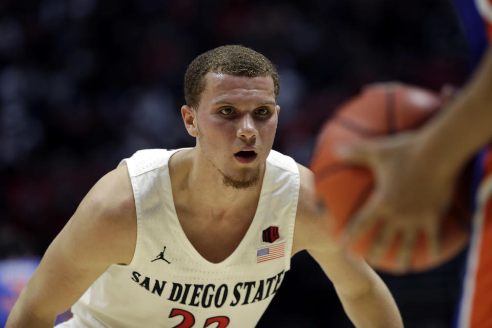 San Diego State guard Malachi Flynn, left, guards Boise State guard RayJ Dennis during the first half of an NCAA college basketball game Saturday, Jan. 11, 2020, in San Diego. (AP Photo/Gregory Bull)