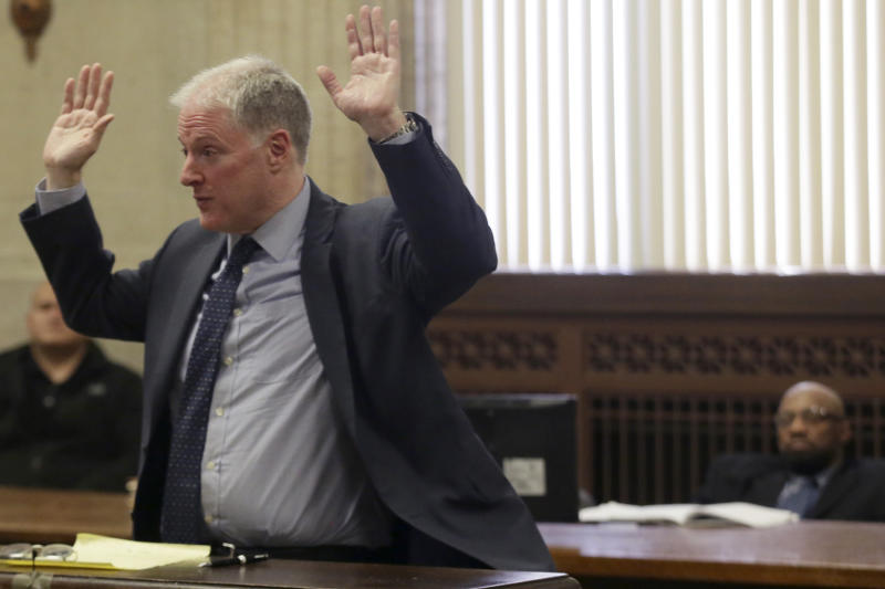 Attorney Scott Kamin speaks during opening statements in the trial of his client, Shomari Legghette, right, during Legghette's murder trial on Tuesday, March 3, 2020, at the Leighton Criminal Court Building in Chicago. Legghette's accused of killing Chicago police Cmdr. Paul Bauer on Feb. 13, 2018. (Stacey Wescott/Chicago Tribune via AP, Pool)