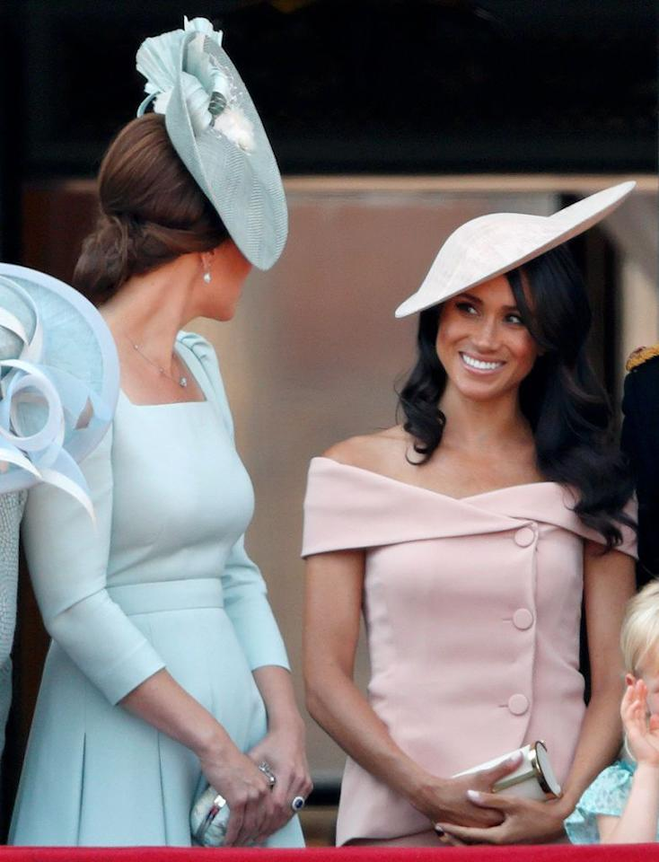"""<p>Meghan's first Trooping the Colour! <a href=""""https://www.townandcountrymag.com/society/tradition/a21240985/meghan-markle-pink-dress-trooping-the-colour-2018/"""" target=""""_blank"""">The Duchess looked picture perfect</a> in a blush off-the-shoulder dress by Carolina Herrera, worn with a hat by Philip Treacy and CH Carolina Herrera's Metropolitan Clutch.<br><a class=""""body-btn-link"""" href=""""https://www.neimanmarcus.com/Philip-Treacy-Overlaid-Straw-Derby-Hat-w-Rosettes/prod207960166/p.prod"""" target=""""_blank"""">SHOP SIMILAR</a> Neutral Straw Hat by Philip Treacy, $1,377 </p><p><a class=""""body-btn-link"""" href=""""https://shop.nordstrom.com/s/gal-meets-glam-collection-tyler-off-the-shoulder-scuba-crepe-dress/4920330"""" target=""""_blank"""">SHOP SIMILAR</a> Pale Pink Off-the-Shoulder Dress by Gal Meets Glam, $168</p>"""