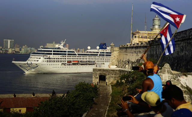 People waving Cuban flags greet Carnival's Adonia cruise ship as it arrives in Havana in May 2016. (Photo: Ramon Espinosa/AP)