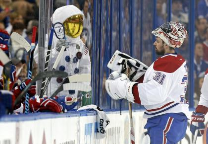TAMPA, FL - MAY 12: A Tampa Bay Lightning fan dressed as an astronaut cheers in front of Carey Price #31 of the Montreal Canadiens in Game Six of the Eastern Conference Semifinals during the 2015 NHL Stanley Cup Playoffs at Amalie Arena on May 12, 2015 in Tampa, Florida. (Photo by Mike Carlson/Getty Images)