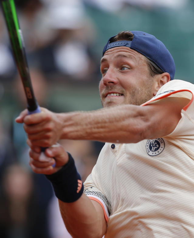 France's Lucas Pouille returns a shot against Russia's Karen Khachanov during their third round match of the French Open tennis tournament at the Roland Garros stadium in Paris, France, Friday, June 1, 2018. (AP Photo/Michel Euler)