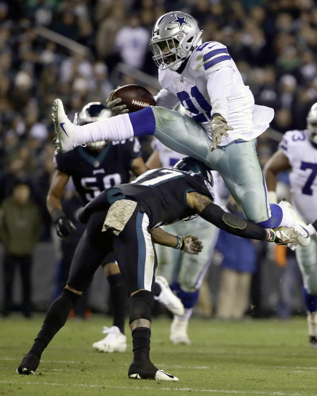 FILE - In this Nov. 11, 2018, file photo, Dallas Cowboys running back Ezekiel Elliott (21) hurdles over Philadelphia Eagles defensive back Tre Sullivan (37) during the first half of an NFL football game, in Philadelphia. The Eagles play at the Cowboys on Sunday. (AP Photo/Matt Rourke, File)
