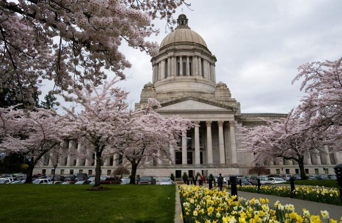 "<span class=""caption"">Washington state cut both merit raises and instituted furloughs as it faced a projected $8.8 billion budget deficit because of the coronavirus.</span> <span class=""attribution""><a class=""link rapid-noclick-resp"" href=""https://www.gettyimages.com/detail/news-photo/washington-state-olympia-state-capitol-building-with-spring-news-photo/452908636?adppopup=true"" rel=""nofollow noopener"" target=""_blank"" data-ylk=""slk:Wolfgang Kaehler/LightRocket via Getty Images"">Wolfgang Kaehler/LightRocket via Getty Images</a></span>"