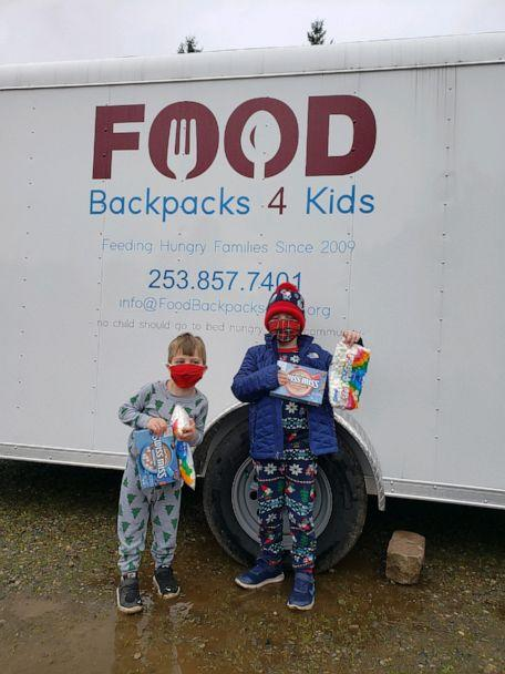 PHOTO: Duke and Hudson Galligan drop off hot cocoa and marshmallows to Food Backpacks 4 Kids. (Michelle Johnson)