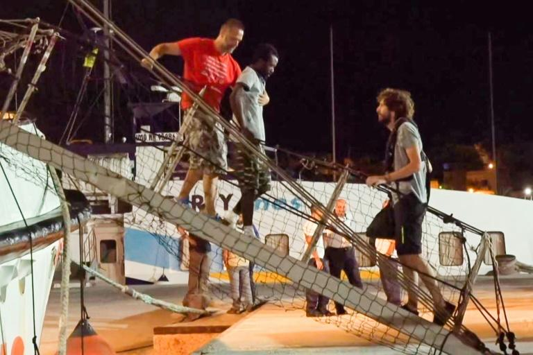 As the migrants walked down the gangplank one by one to Lampedusa's shore overnight, some could be seen limping or in bandages