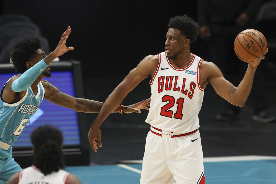 Chicago Bulls forward Thaddeus Young (21) looks to pass the ball as Charlotte Hornets forward Jalen McDaniels defends during the first quarter of an NBA basketball game in Charlotte, N.C., Thursday, May 6, 2021. (AP Photo/Nell Redmond)