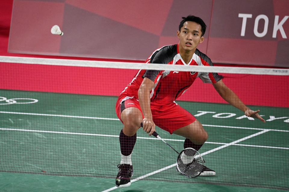 Indonesia's Jonatan Christie hits a shot in his men's singles badminton group stage match against Refugee Olympic Team's Aram Mahmoud during the Tokyo 2020 Olympic Games at the Musashino Forest Sports Plaza in Tokyo on July 24, 2021. (Photo by Alexander NEMENOV / AFP) (Photo by ALEXANDER NEMENOV/AFP via Getty Images)