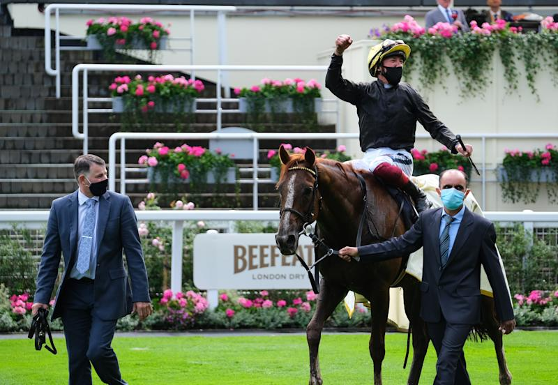 Stradivarius and Frankie Dettori are lead into the winners enclosure after victory in the Gold Cup at Royal Ascot