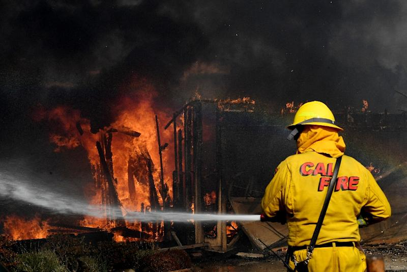 The National Weather Service said easterly Santa Ana winds fueling the fire had registered gusts of up to 55 miles per hour (80 kilometers per hour) (AFP Photo/MARK RALSTON)