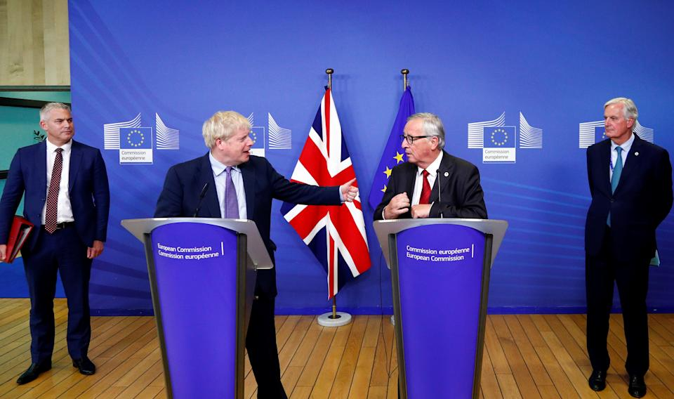 Britain's Prime Minister Boris Johnson, European Commission President Jean-Claude Juncker, European Union's chief Brexit negotiator Michel Barnier and Britain's Brexit Secretary Stephen Barclay attend a news conference after agreeing on the Brexit deal, at the sidelines of the European Union leaders summit, in Brussels, Belgium October 17, 2019. REUTERS/Francois Lenoir