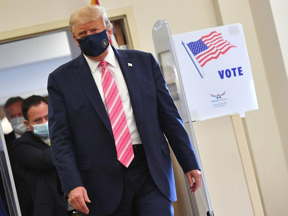 President Donald Trump leaves after casting his ballot at the Palm Beach County Public Library, during early voting for the 3 November election (AFP via Getty Images)