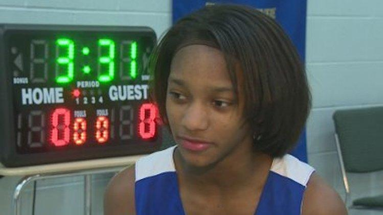 Janya Lilly, 13, made her school's boys' basketball team and earned co-captain status -- WBAL-TV