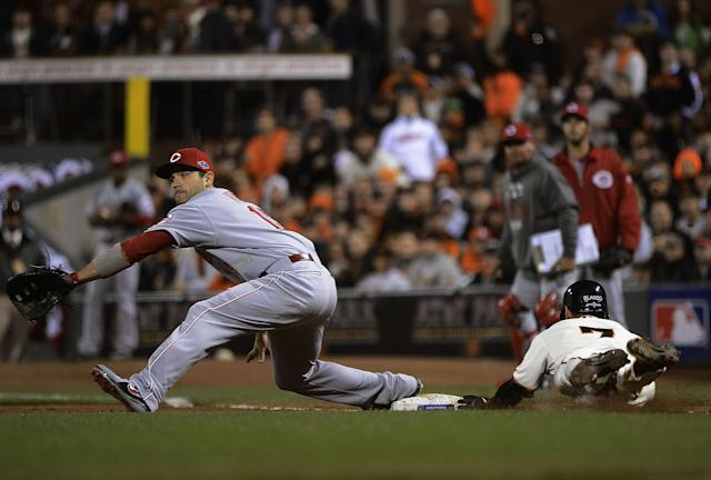 SAN FRANCISCO, CA - OCTOBER 06: Gregor Blanco #7 of the San Francisco Giants dives to beat out a bunt and throw to Joey Votto #19 of the Cincinnati Reds during the sixth inning in Game One of the National League Division Series at AT&T Park on October 6, 2012 in San Francisco, California. (Photo by Thearon W. Henderson/Getty Images)